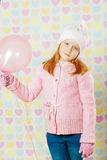 Little girl in a pink hat and a sweater Stock Photography