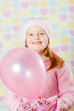 Little girl in a pink hat and a sweater Royalty Free Stock Photo