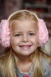 Little girl in pink headphones Stock Image