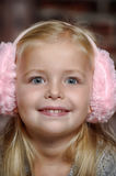 Little girl in pink headphones Royalty Free Stock Images