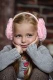 Little girl in pink headphones Royalty Free Stock Image