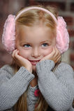 Little girl in pink headphones Royalty Free Stock Photo
