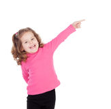 Little girl in pink indicating something Royalty Free Stock Image