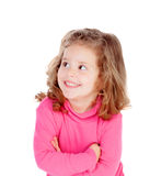 Little girl in pink looking at side Stock Images