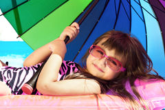 Little girl on a pink mattress royalty free stock photo