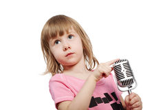 Little girl in pink with microphone Royalty Free Stock Photography