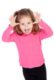 Little girl in pink mocking Royalty Free Stock Image