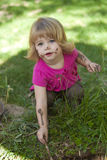 Little girl in pink with muddy face. Little girl outside with pink top and muddy face royalty free stock images