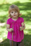 Little girl in pink with muddy face. Little girl outside with pink top and muddy face royalty free stock photos