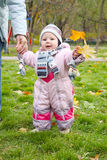 Little girl in pink overalls Royalty Free Stock Images