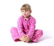 Little girl in pink pajamas Stock Images