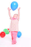Little girl in a pink pajamas Royalty Free Stock Image