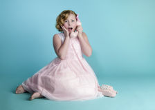 Little Girl on Pink Phone Stock Photos