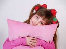Little girl with a pink pillow Royalty Free Stock Image