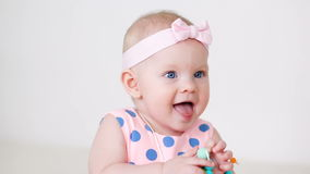Little girl in a pink polka dot dress with bandage on head stock footage