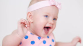 Little girl in a pink polka dot dress with bandage on head stock video