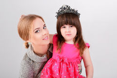 Little girl in pink Princess dress with crown and beautiful moth Stock Photography