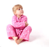 Little girl in pink pyjamas Stock Photo