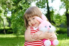 Little girl with pink rabbit Royalty Free Stock Image
