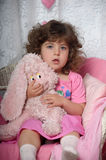 Little girl with a pink rabbit Stock Photos