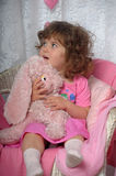 Little girl with a pink rabbit Royalty Free Stock Photography