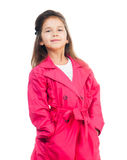Little girl in a pink raincoat Royalty Free Stock Photography