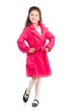 Little girl in a pink raincoat Royalty Free Stock Photos