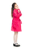 Little girl in a pink raincoat Royalty Free Stock Image