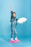 Little girl in pink roller skates holding speech bubble in studio stock photos