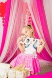 Little girl in a  pink skirt Stock Photos
