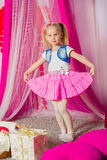Little girl in a  pink skirt Stock Images