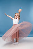 Little girl in pink skirt posing in studio Royalty Free Stock Photography