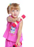 Little girl in a pink suit. Royalty Free Stock Photo