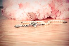 Little girl in pink tulle tutu with pearls Stock Images