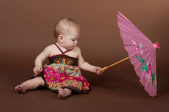 A little girl a pink umbrella Royalty Free Stock Photo