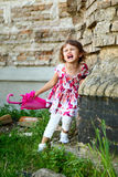 Little girl  with pink umbrella crying Stock Photography