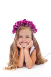 Little girl with pink violet floral wreath Royalty Free Stock Photos