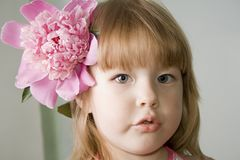 Little girl with pion Stock Photography
