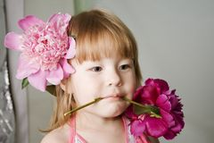 Little girl with pions Stock Images