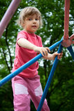 Little girl on pipes on playground Royalty Free Stock Photos