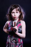 Little girl with pistol Royalty Free Stock Photos