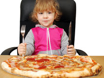 Little girl with pizza Stock Photo