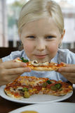 Little girl and pizza Royalty Free Stock Images