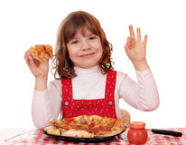 Little girl with pizza and ok hand sign Stock Photo