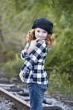 Little girl with plaid shirt and hat Royalty Free Stock Image