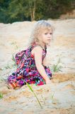 Little girl plaing alone at riverside Stock Photography