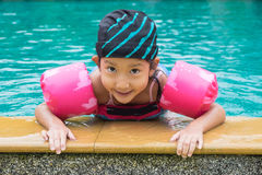 Little girl plaing in swimming pool Royalty Free Stock Image