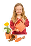 Little girl planting flowers in pots Stock Photos