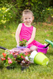 Little girl planting flowers Stock Photography