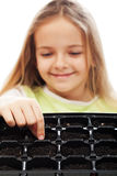 Little girl planting putting seeds into germination tray Royalty Free Stock Photo